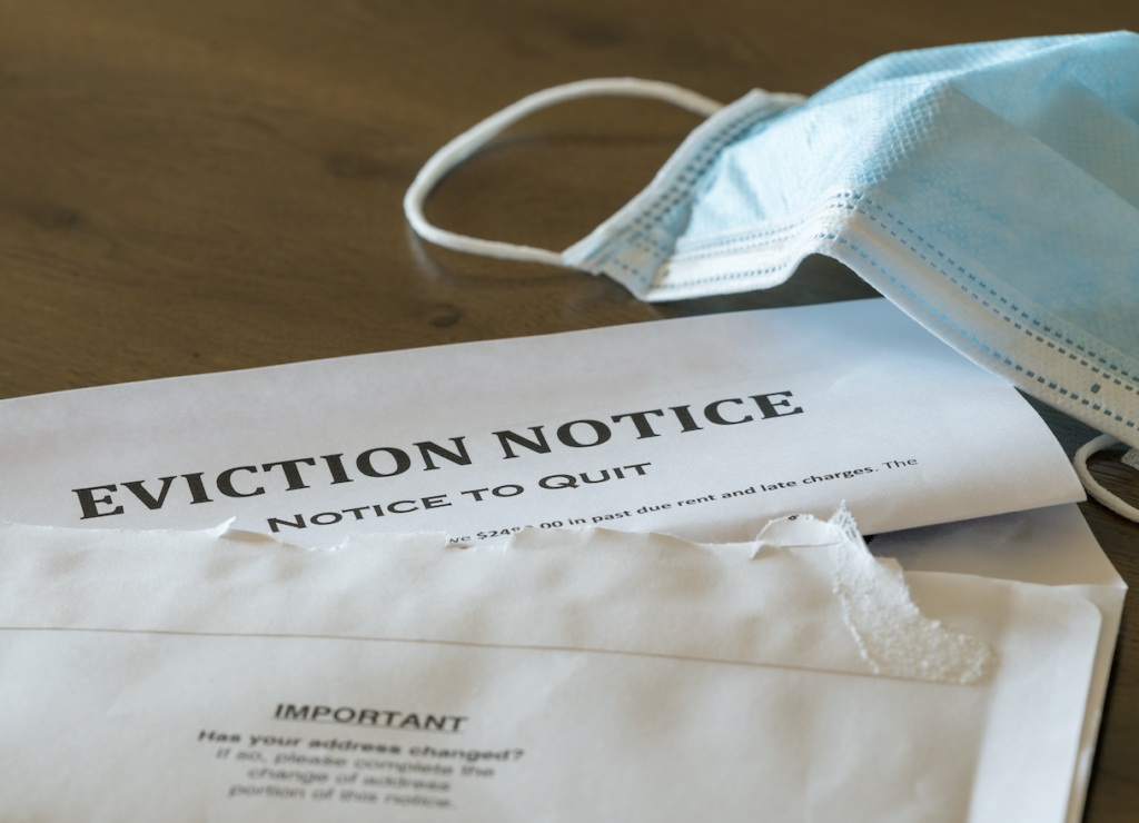 Eviction Notice with a surgical mask to represent covid eviction policies